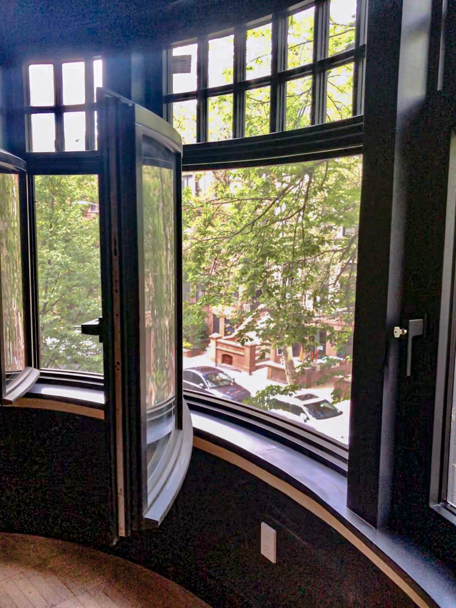 Curved, operable, triple-glazed bay window by Bildau & Bussmann