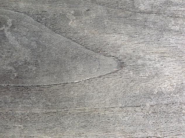 closeup of a weathered grey teak decking samples